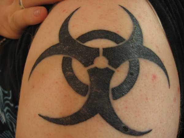 Dark Black Tribal Biohazard Symbol Tattoo On Shoulder