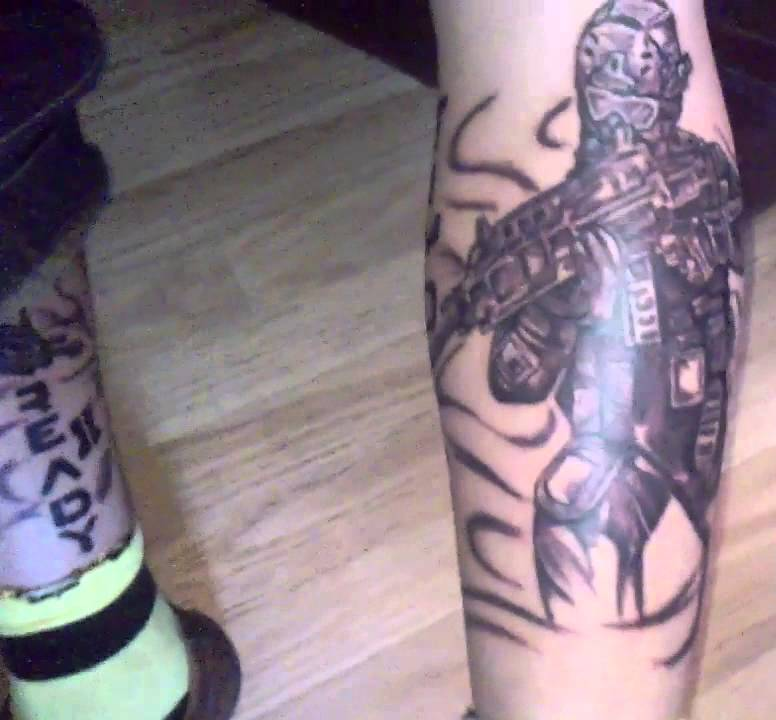 Dark Grey Ink Video Game Tattoo