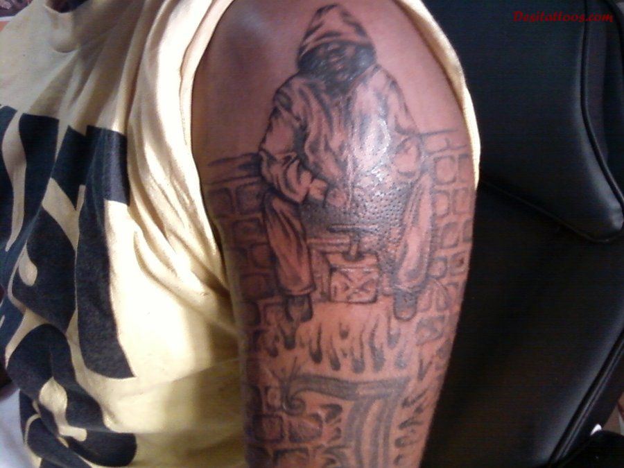 Dark Thug And Flames Tattoos On Arm