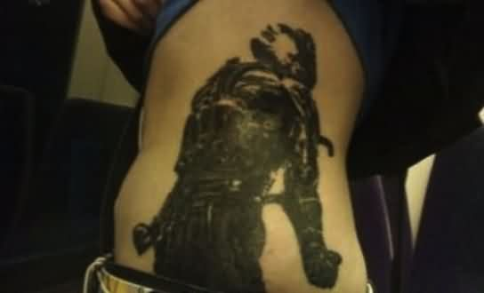 Dark Video Game Tattoo On Side Rib