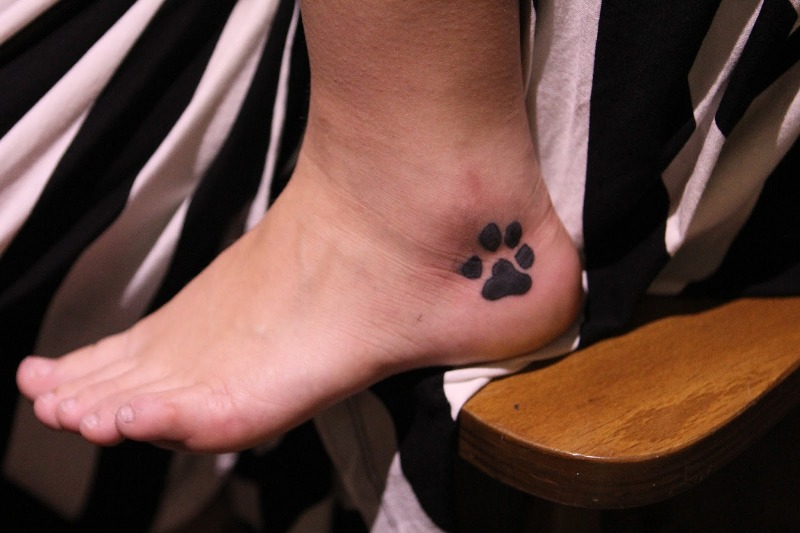 Dog Paw Outer Ankle Tattoo