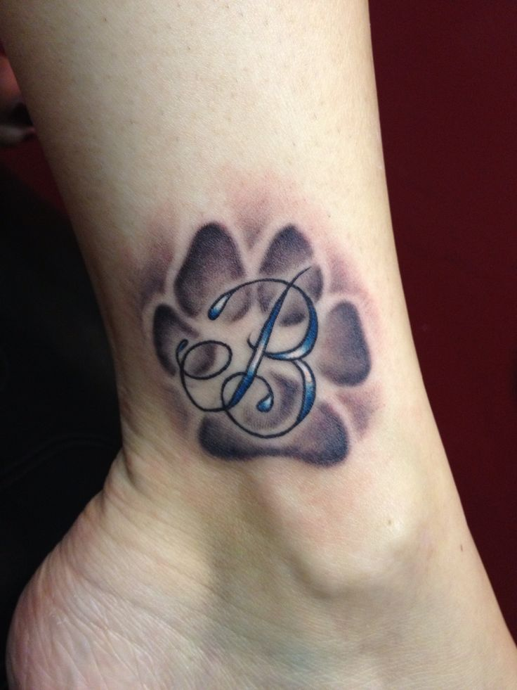 Dog Paw Print With Initial Tattoo On Ankle