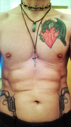 Dragon Heart And Pistol Tattoos On Front Body