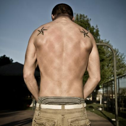 Dual Nautical Star Tattoos Behind Shoulders