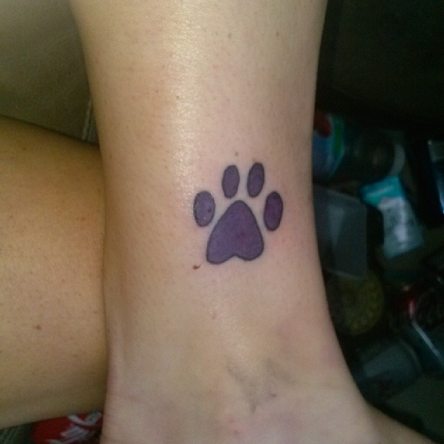 Elegant Purple Paw Print Tattoo On Ankle
