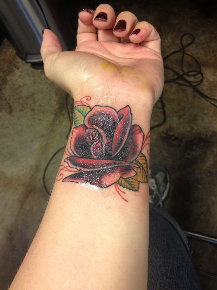 Elegant Red Rose And Swirl Tattoos On Wrist