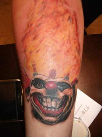 Flames And Evil Clown Tattoos