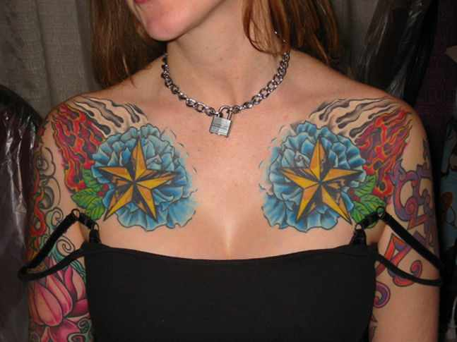 Flames And Golden Nautical Tattoos On Front Of Shoulders