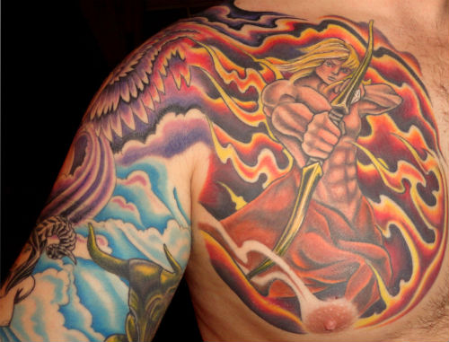 Flames And Sagittarius Tattoo On Chest