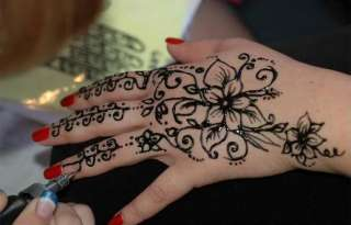 Fresh Henna Flower Tattoos On Hand