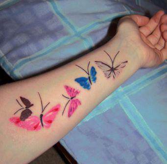 Fresh Ink Butterfly Tattoos On Lower Arm