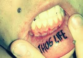 Fresh Ink Thug Life Tattoo On Lower Lip