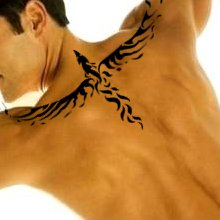Fresh Ink Tribal Phoenix Tattoo On Upperback