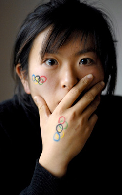 Fresh Olympic Logo Tattoos On Face And Hand