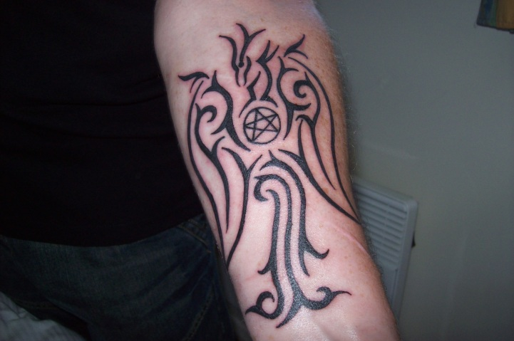 Fresh Pagan Tribal Tattoos On Lower Arm