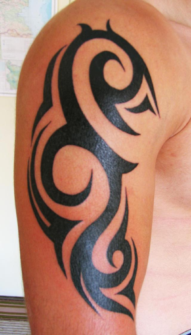 Fresh Tribal Tattoo On Arm For Men