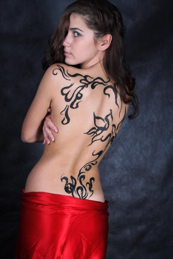 Fresh Tribal Vine Tattoo On The Back
