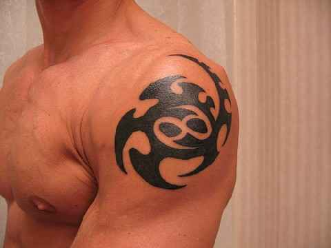 Fresh Tribal Zodiac Cancer Symbol Tattoo On Shoulder