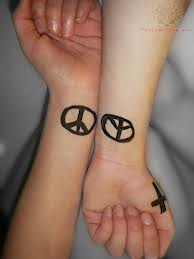 Friends Get Matching Peace Sign Tattoos