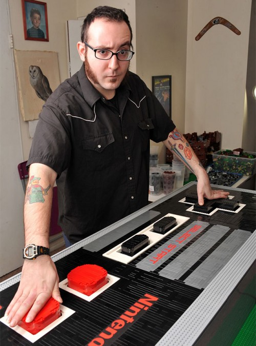 Functional Nes Controller With Video Game Tattoos On Arm