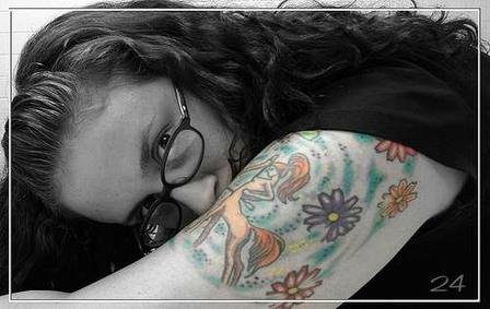 Girl With Color Flowers And Sagittarius Tattoos On Arm
