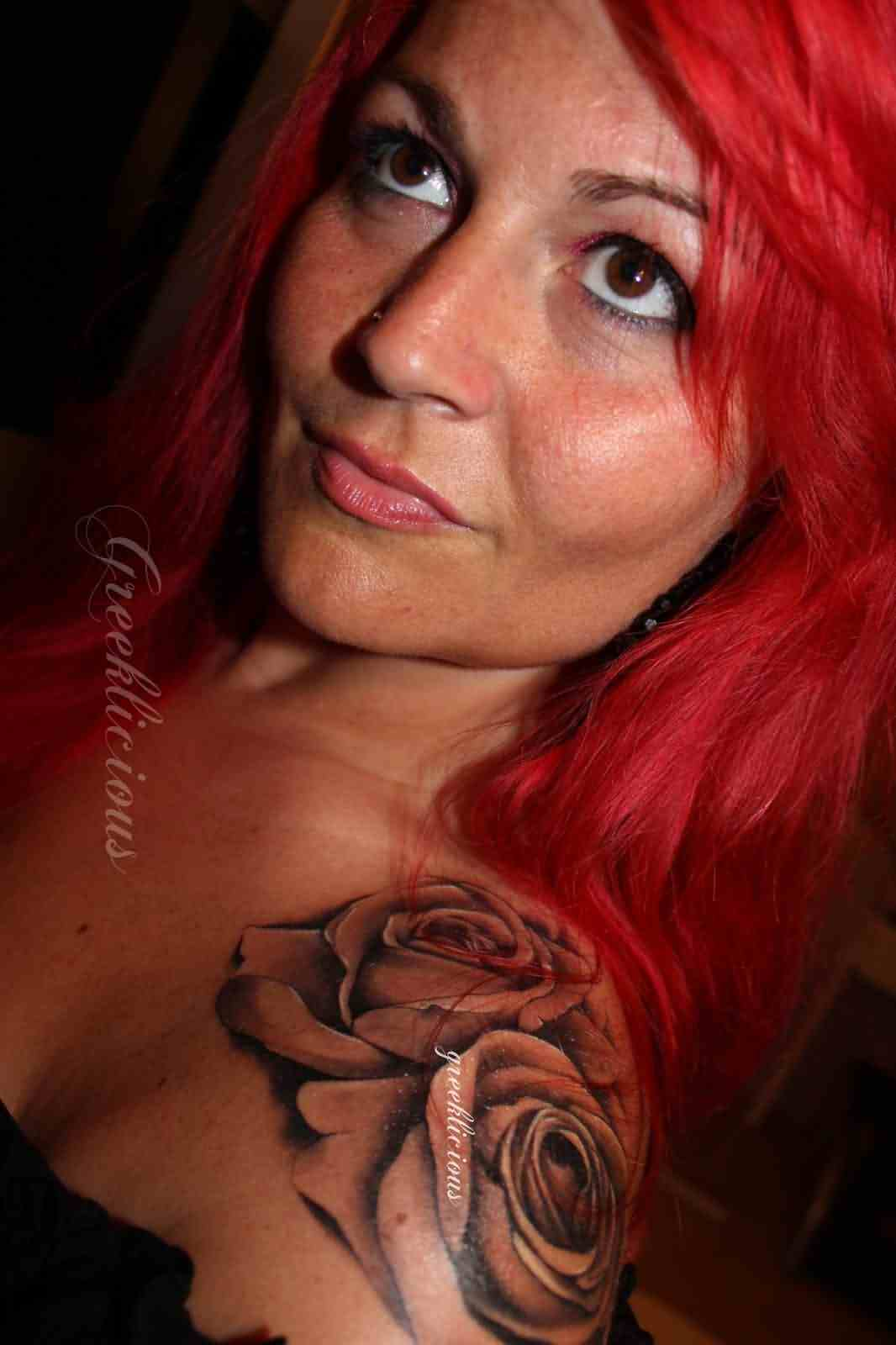 Girl With Red Hairs And Grey Roses Tattoos