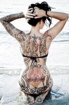 Girl With Tattoos On Beach