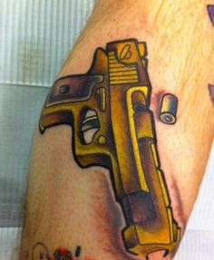 Golden Pistol And Bullet Tattoos