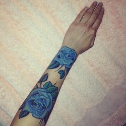 Gorgeous Blue Roses Tattoos On Arm