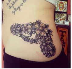 Gorgeous Floral Pistol Tattoo On Waist