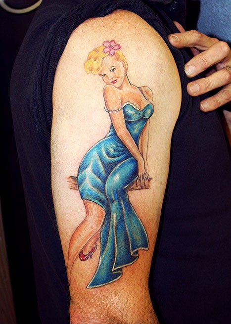 Gorgeous Pin Up Girl On Wooden Branch Tattoo On Arm