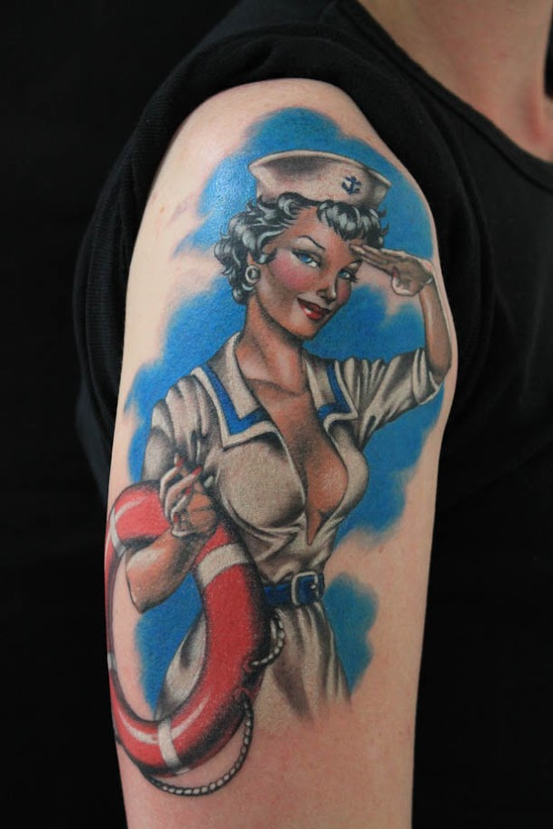 Gorgeous Sailor Pin Up Girl Salute Tattoo On Arm