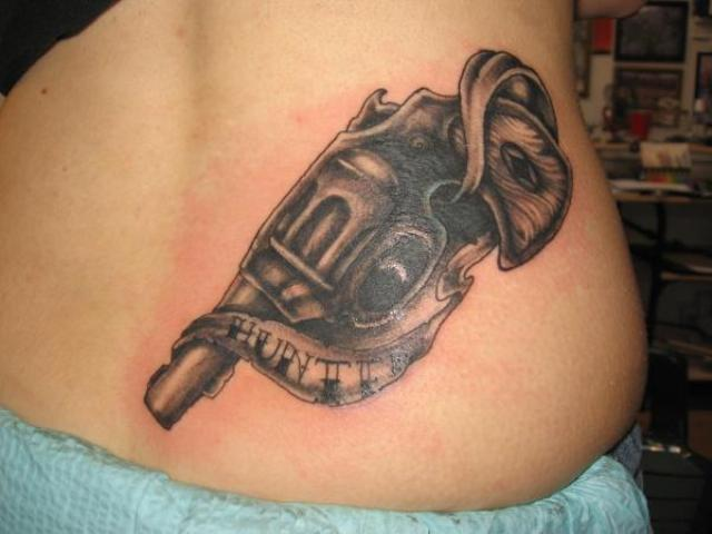 Great Black Gun Tattoo On Back Waist