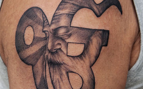 Great Religious Symbol Tattoo Ever