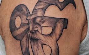 Great Religious Symbol Tattoo For Men