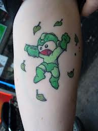 Green Ink Megaman Tattoo On Biceps