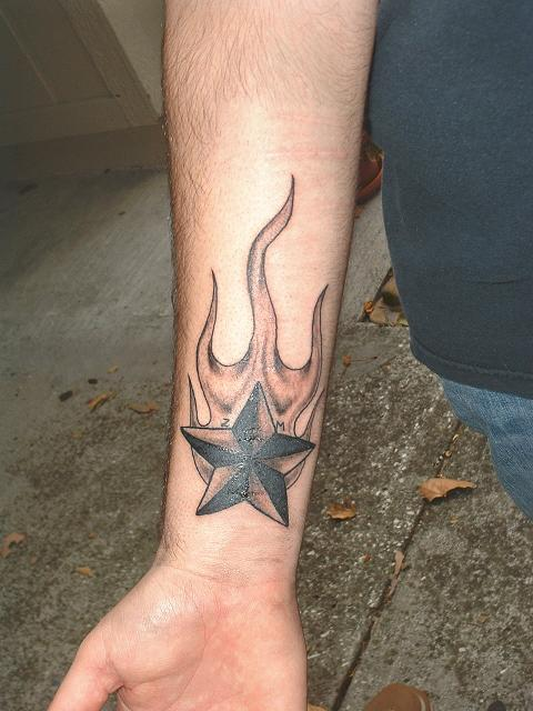 Grey Flames And Nautical Star Tattoos On Wrist