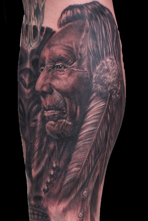 Grey Native American Portrait And Feather Tattoos On Leg