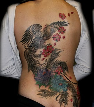 Grey Phoenix And Flower Tattoos On Backbody