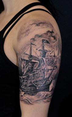 Grey Pirate Ship In Water Tattoo On Biceps