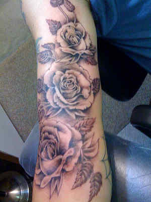 Grey Rose Vine Tattoo On Arm