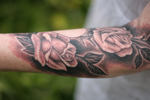 Grey Roses Realistic Tattoos On Arm