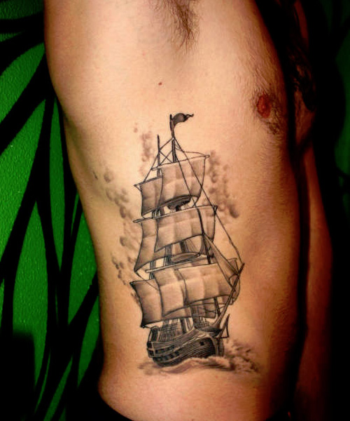 Grey Sailing Pirate Ship Tattoo On Ribs