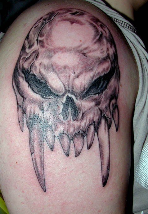 Grey Skull With Sharp Teeth Tattoos On Arm
