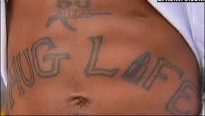 Gun And Thug Life Tattoos On Stomach