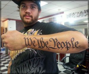 Guy Showing New We The People Tattoo On Arm