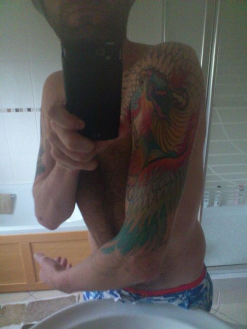 Guy With Japanese Colorful Phoenix Tattoo On Sleeve