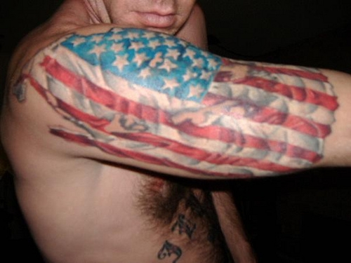 Guy With Patriotic Flag Tattoo