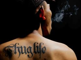 Guy With Thug Life Tattoo On Upperback