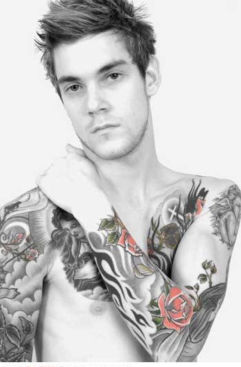 Guy With Tribal And Red Rose Tattoos